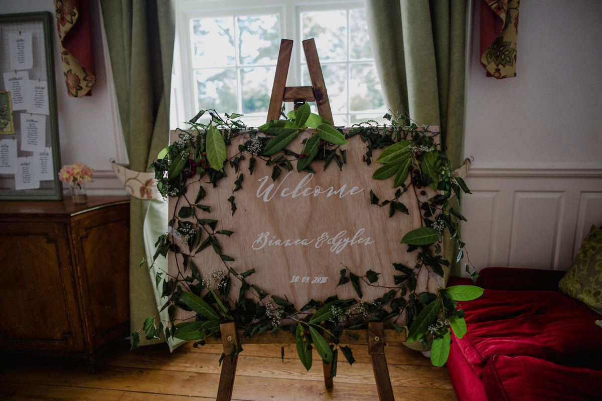Welcome sign for wedding guests at Achnagairn decorated with foliage