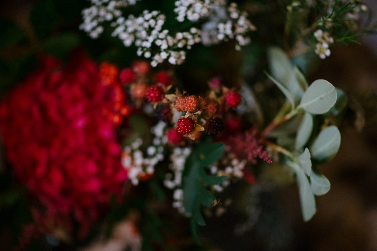 Red berries and floral arrangement