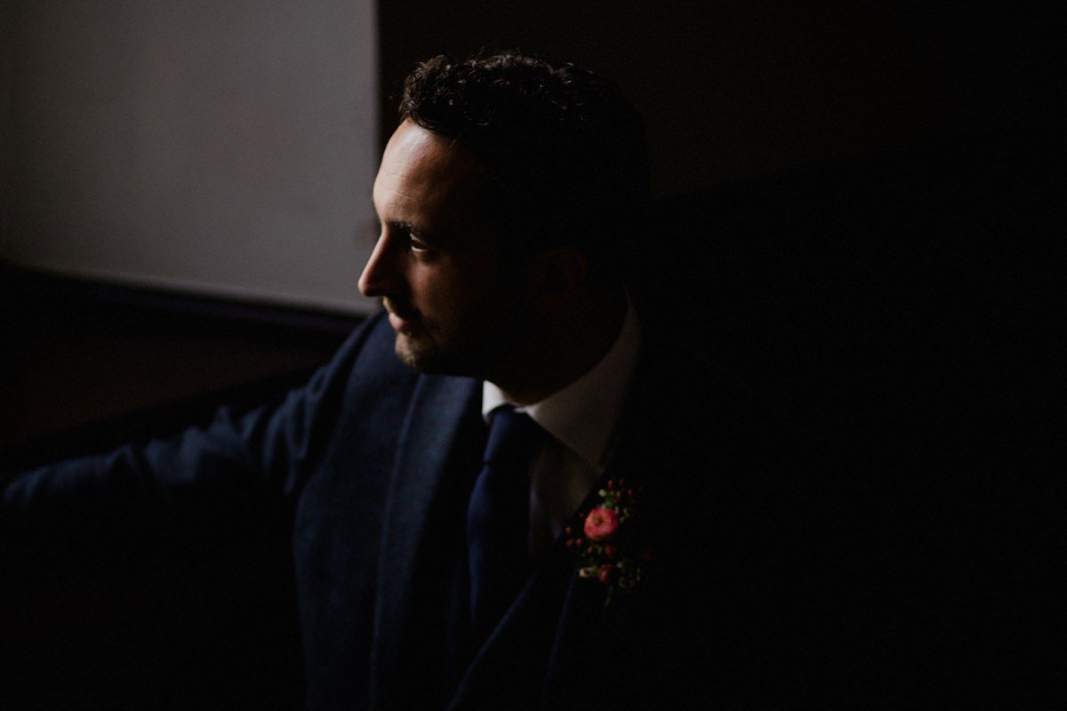 Moody portrait of groom at Achnagairn house