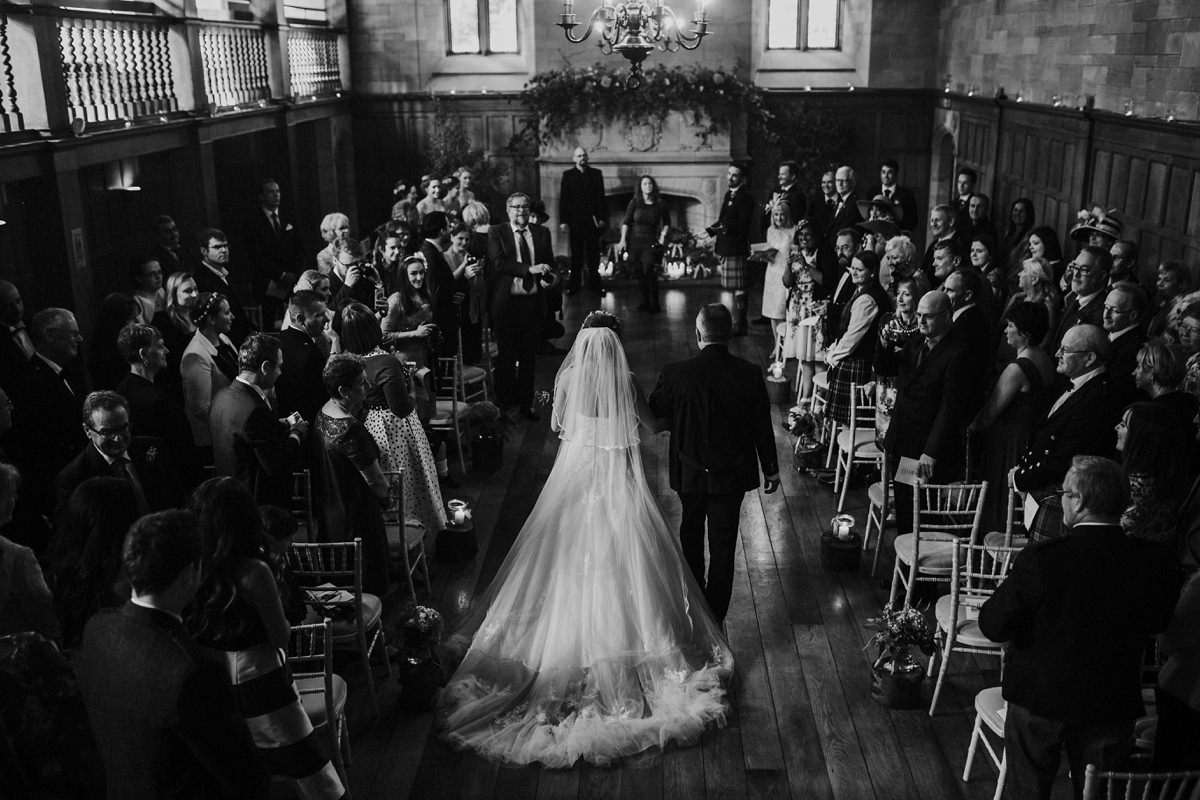 Bride walking up the aisle with her father to meet her groom at Achnagairn House