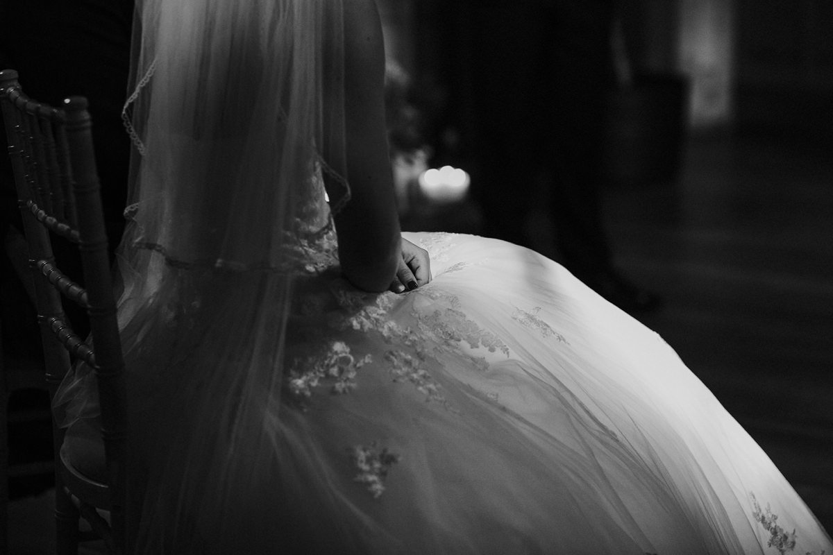 Black and white of bride's dress detail