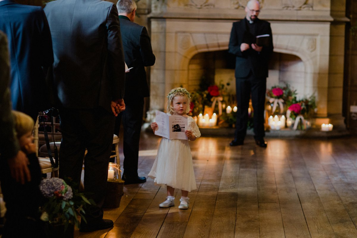 flowergirl in the aisle reading the order of service