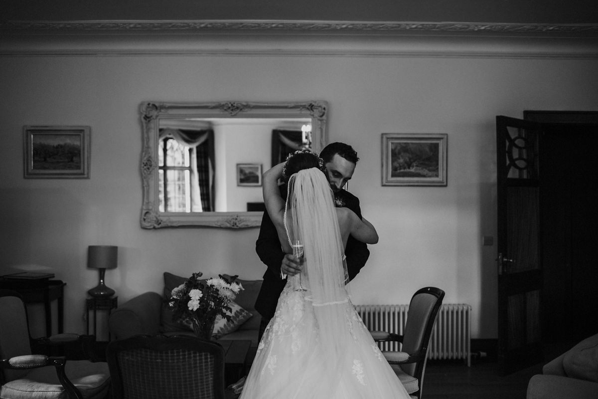 black and white of first hug as married couple
