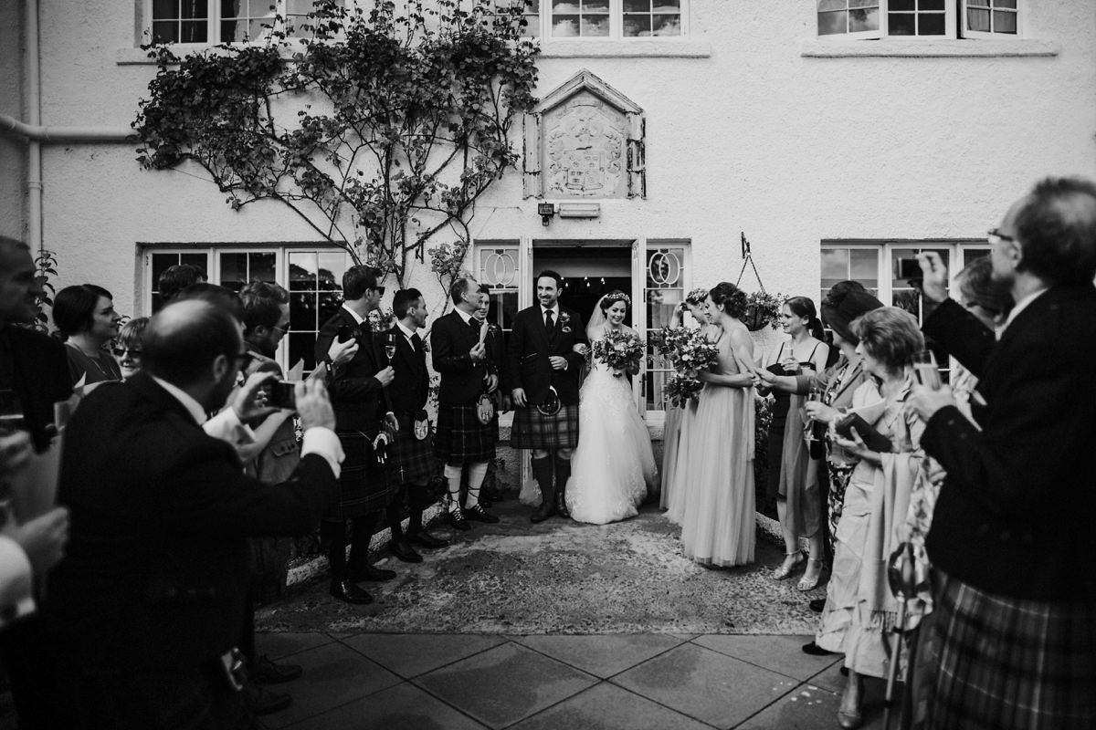 Black and White of bride and groom leaving the ceremony