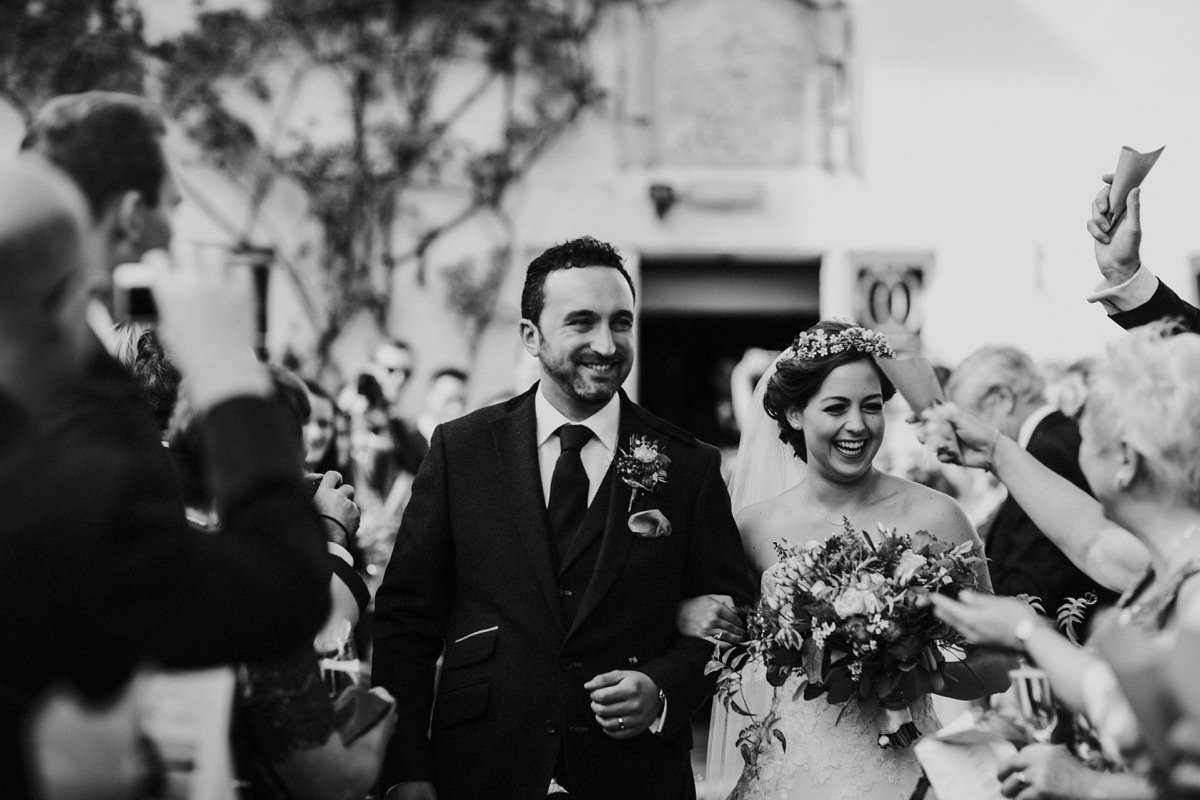black and white of smiling happy bride and groom