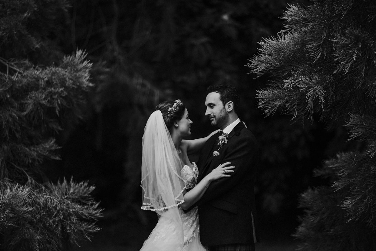 Black and white of bride and groom portrait in the woodland