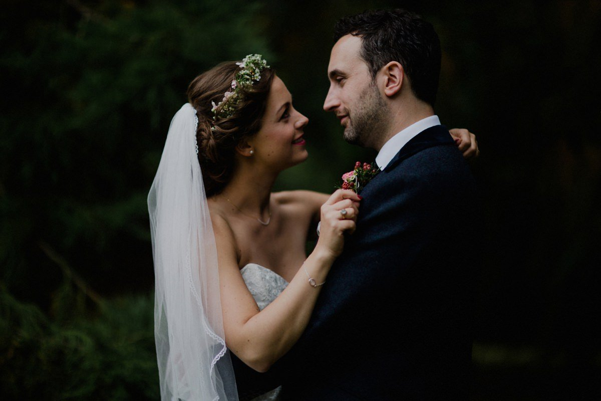 Closeup portrait of bride and groom in the woodland and Achnagairn Estate