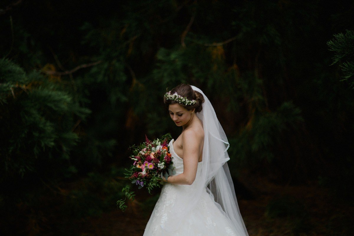 Portrait of bride with floral crown in the woodland