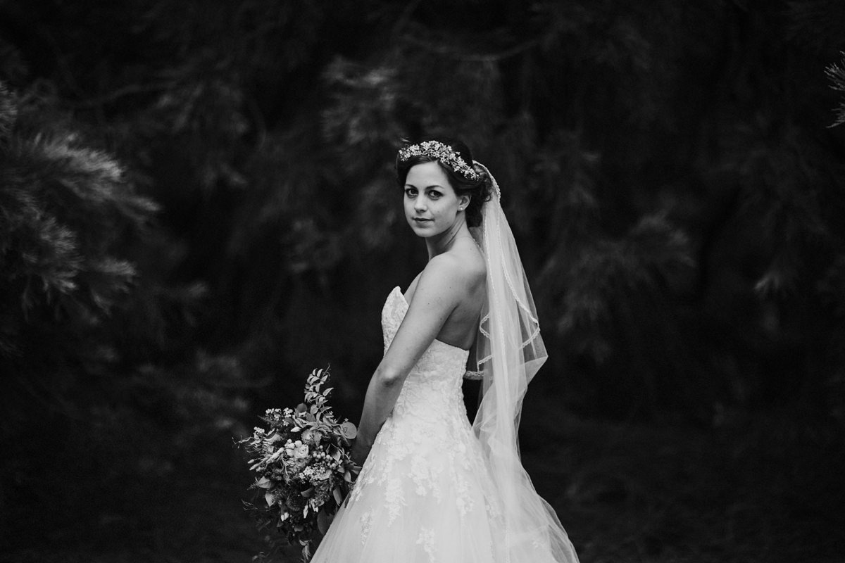 Black and white of bride in woodland