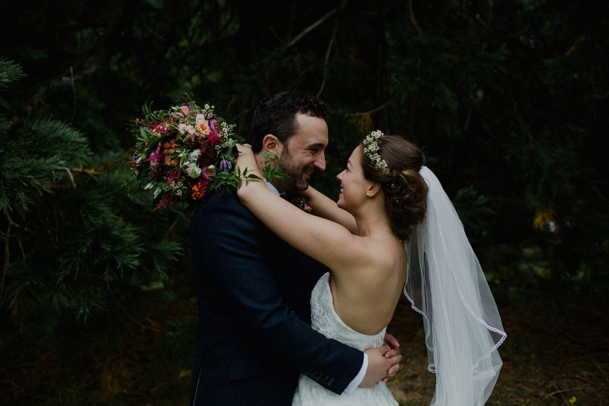 Wedding Couple laughing in an embrace