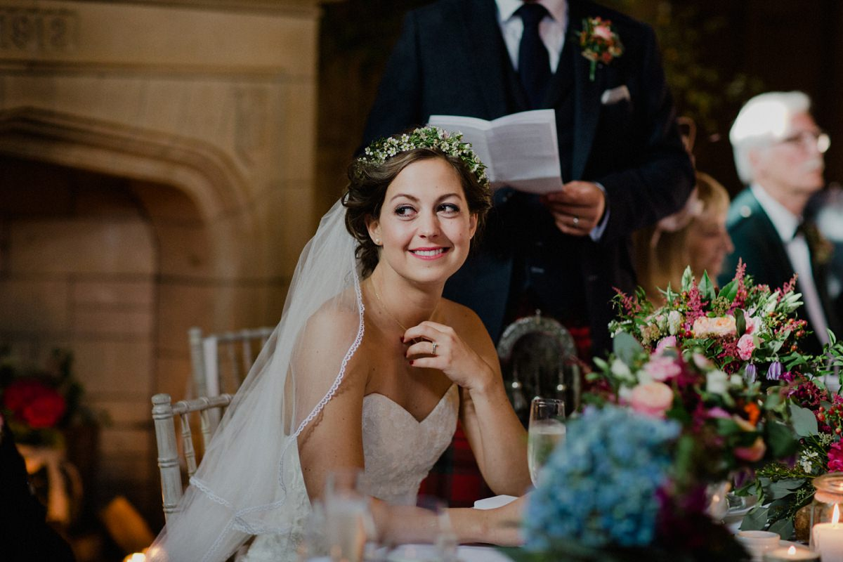 Image of a happy bride during the speeches