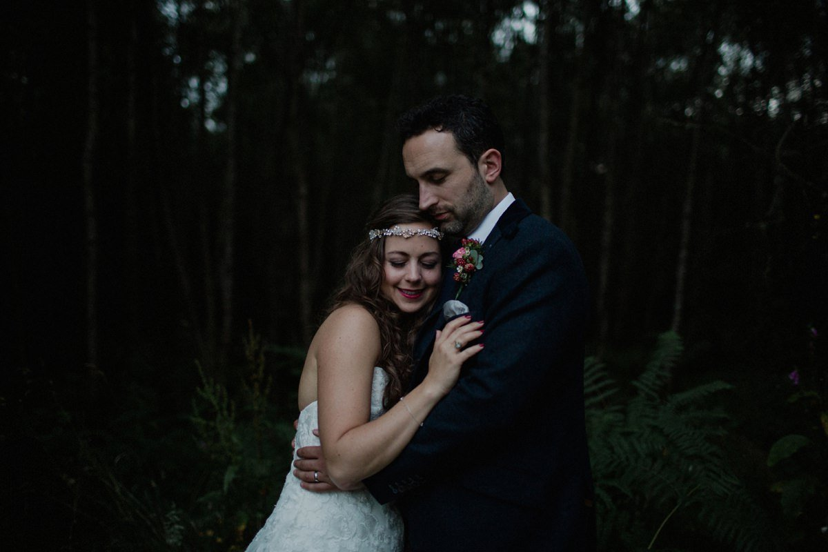 Moody couple portrait in the woodland
