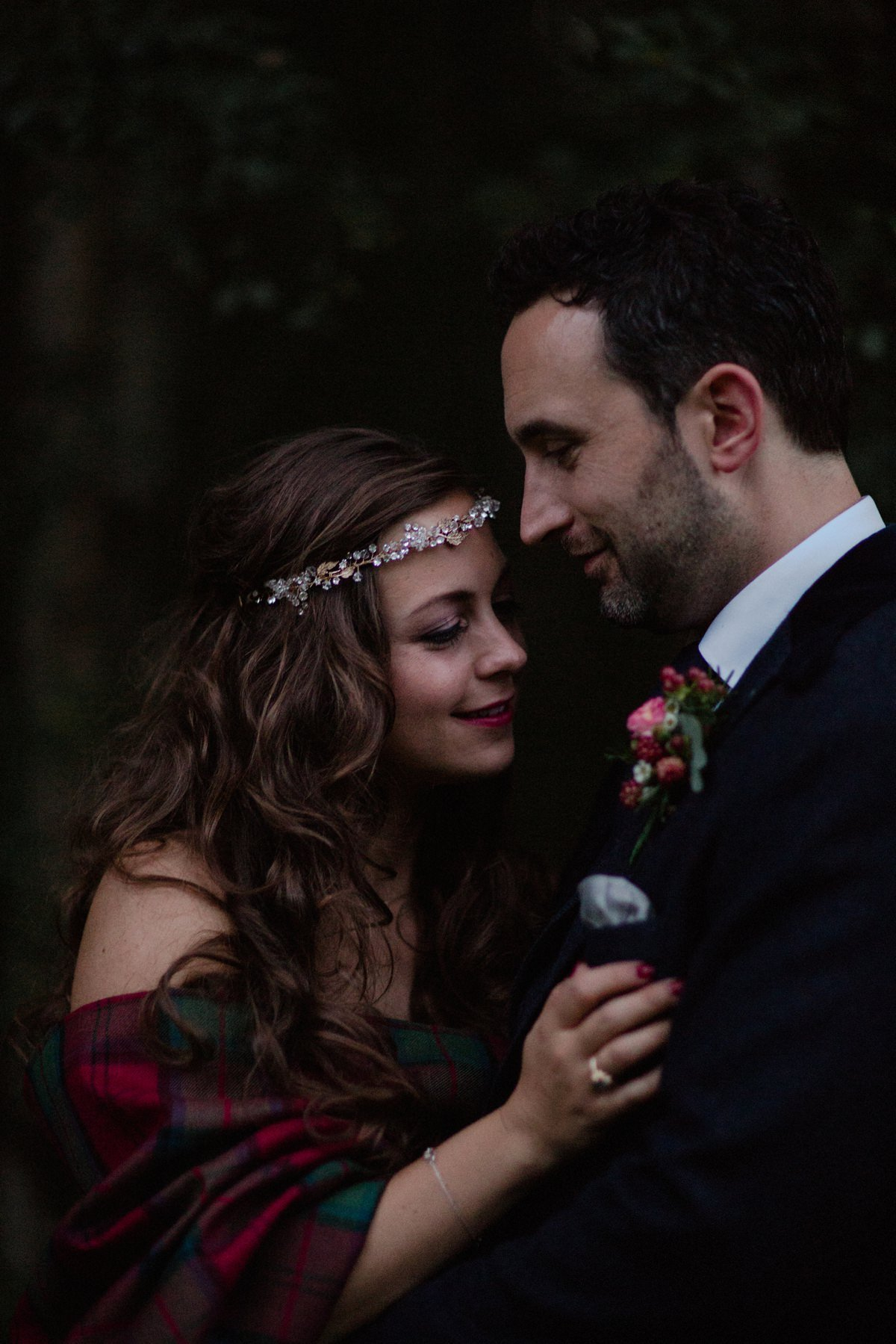 Close moody portrait of wedding couple in a romantic embrace