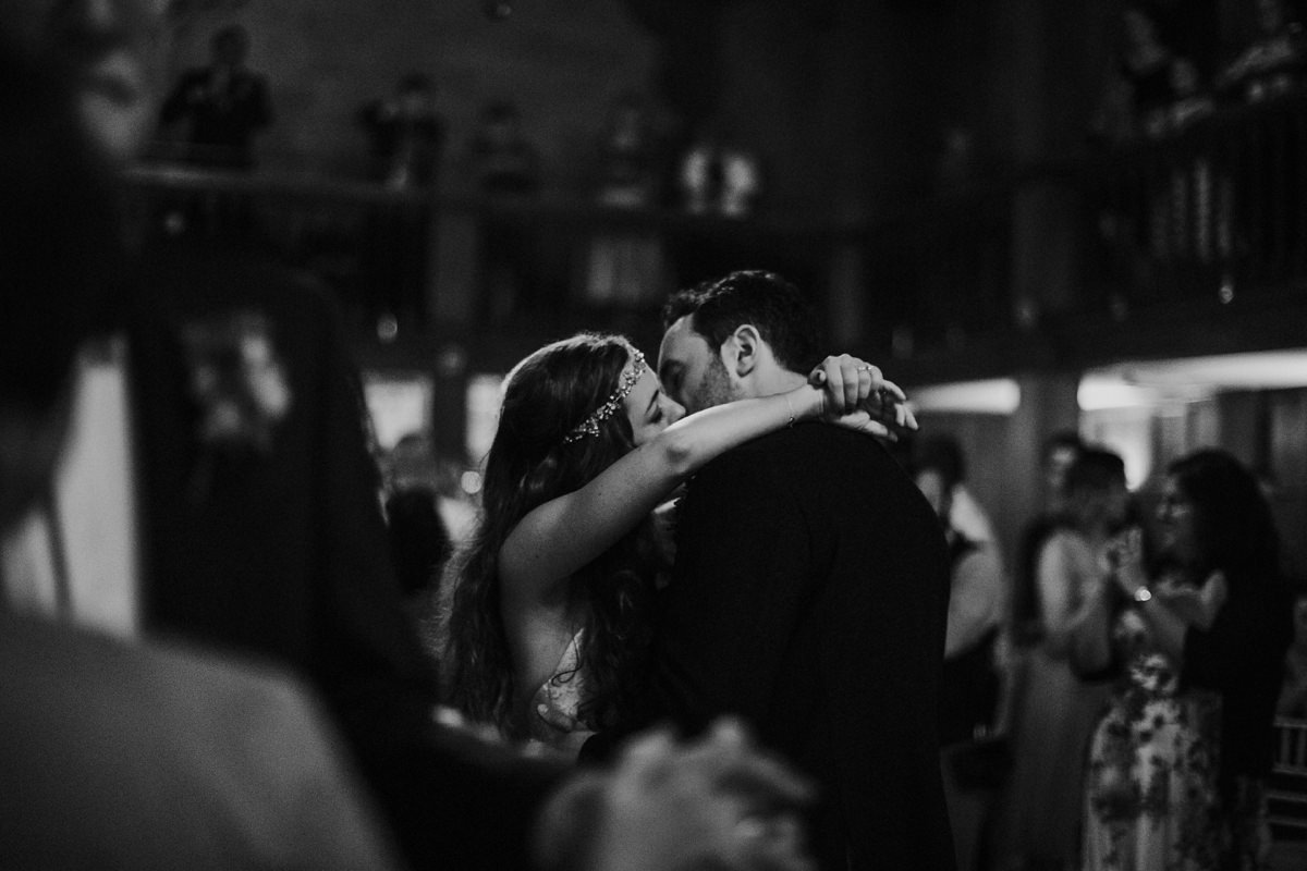 black and white of bride and groom in a romantic embrace during their first dance