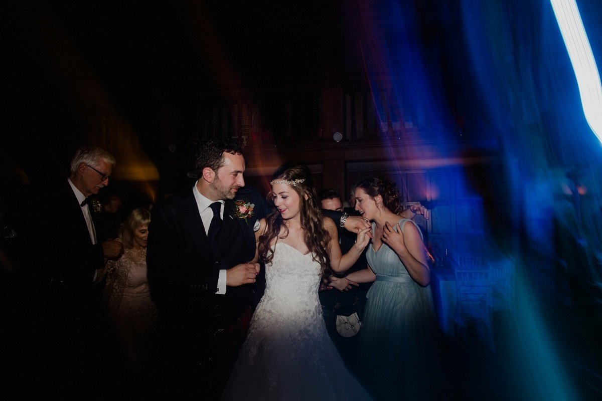 colourful portrait of bride and groom on dancefloor