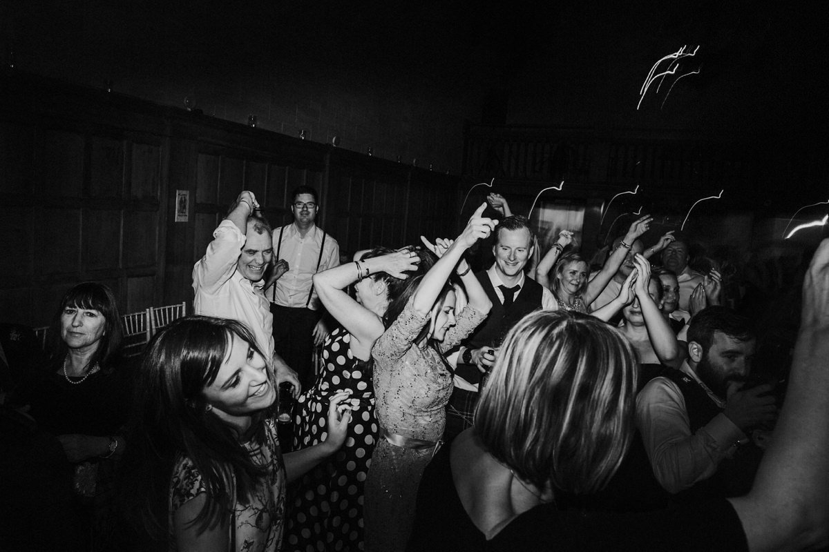 black and white of wedding guests dancing