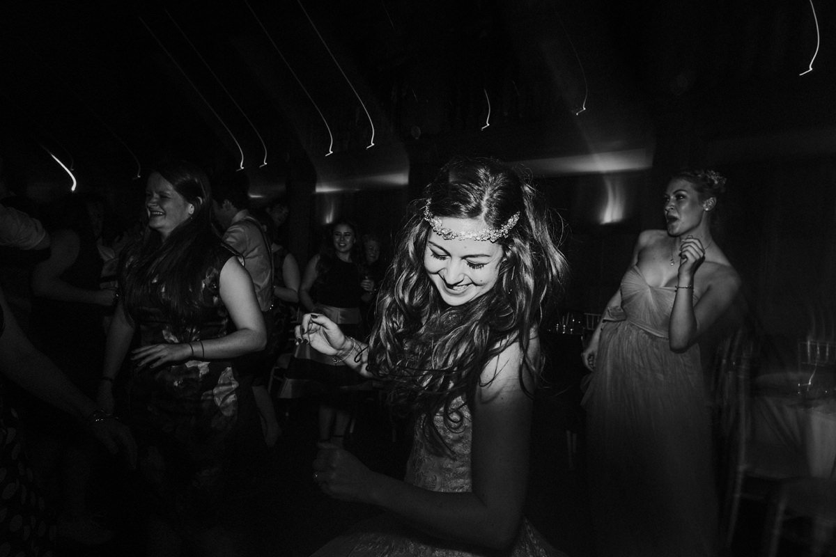 Black and white of happy bride dancing