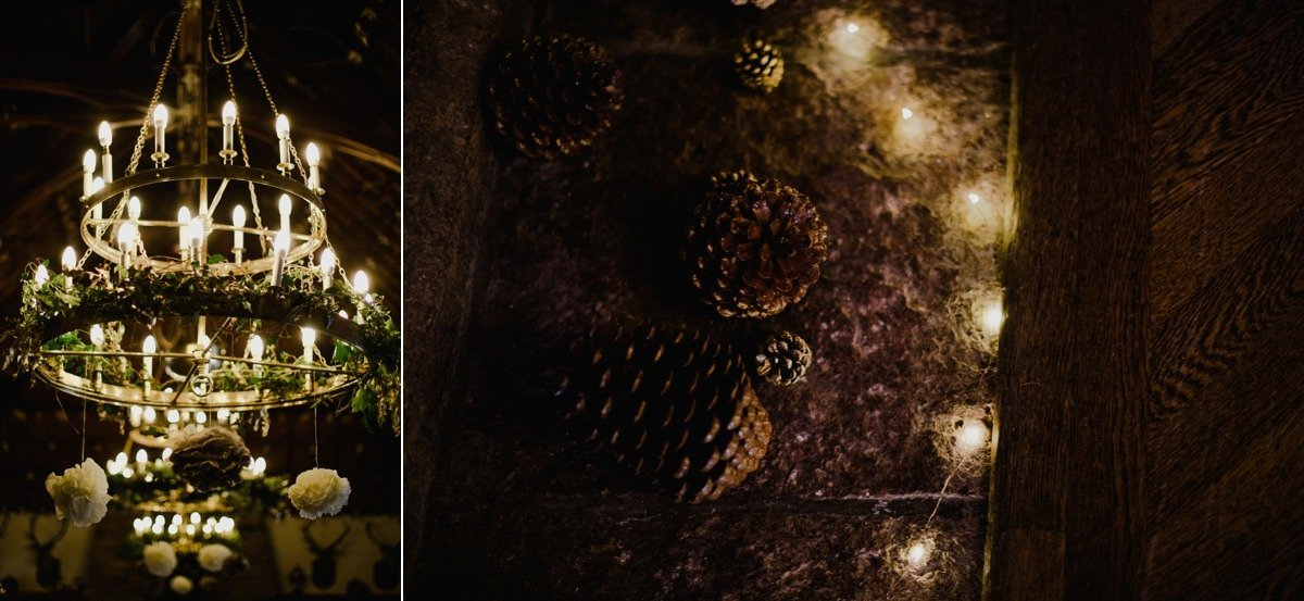 Winter wedding details, chandelier and pinecones by the fireplace