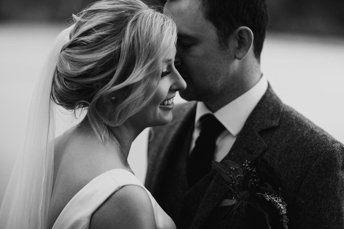 Intimate, romatic Black and White closeup portrait of bride and groom