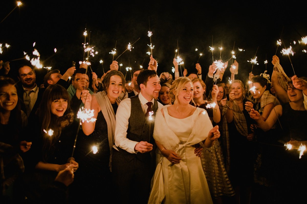 Guests enjoy Sparklers with bride and groom