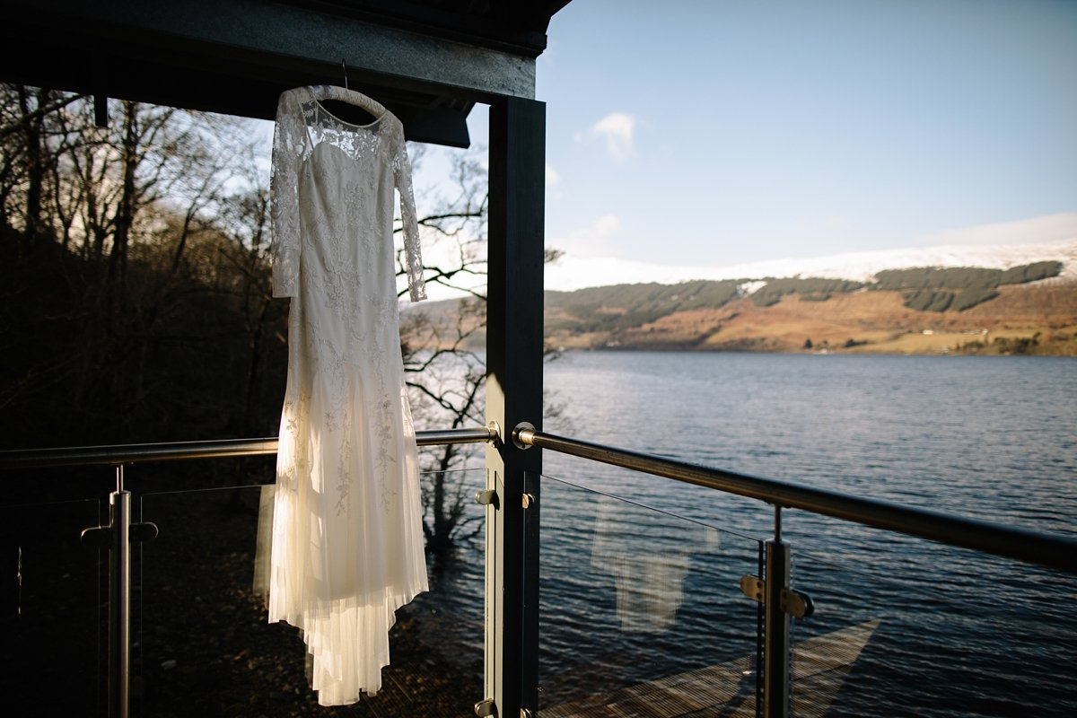 Wedding dress hanging infront of the scenery