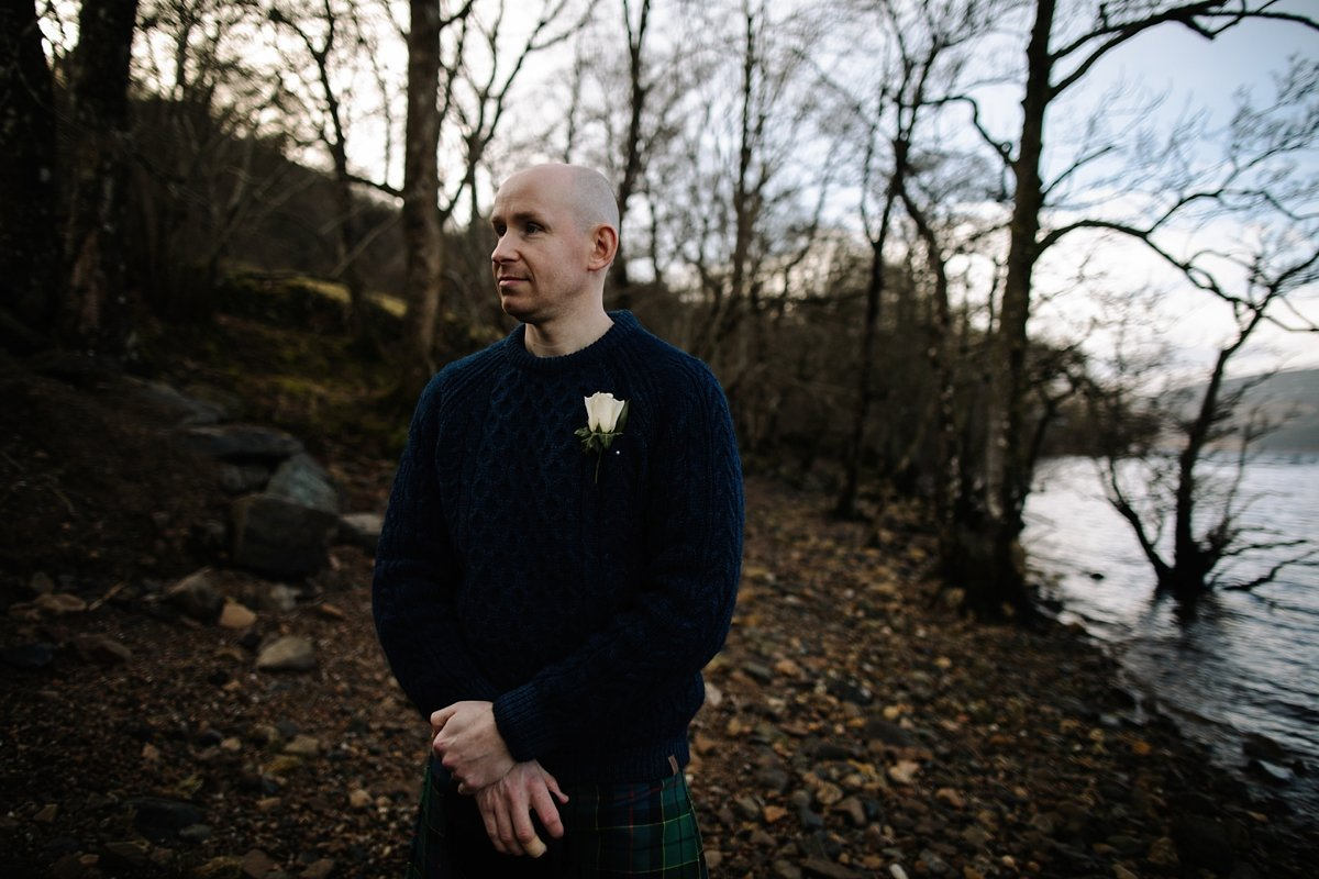 groom waiting by the loch for the ceremony