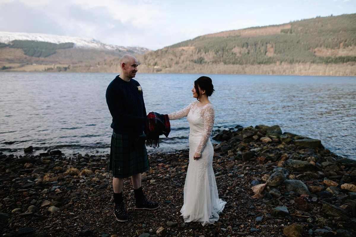Handfasting on the beach using a tartan scarf