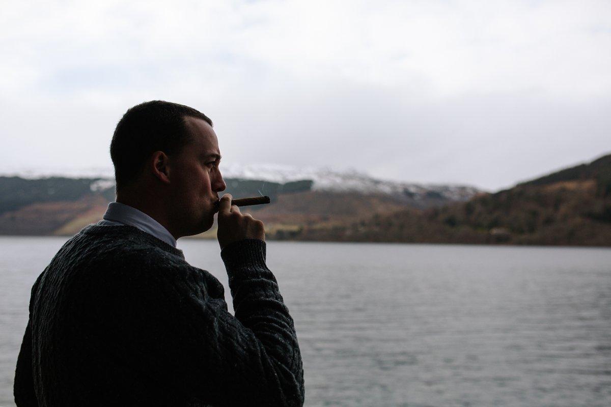 groomsman having a cigar outside