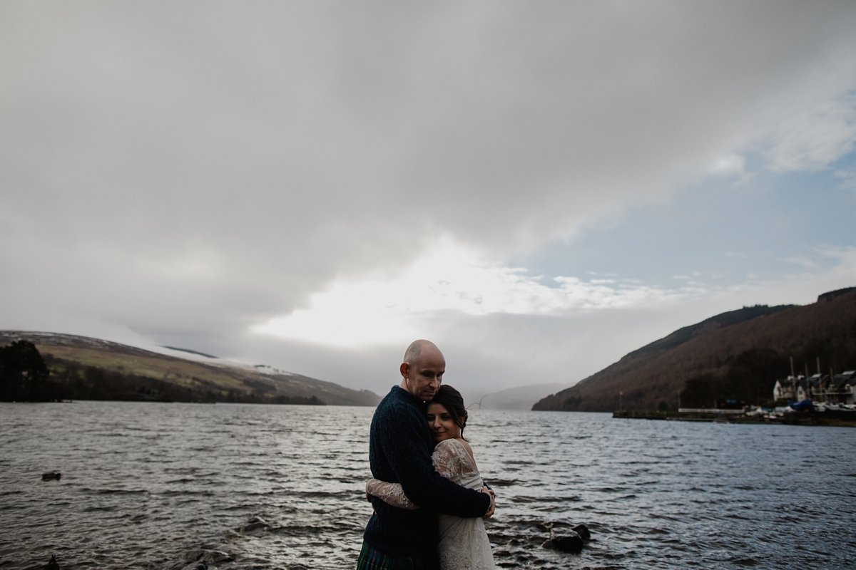 portrait of bride and groom by loch tay
