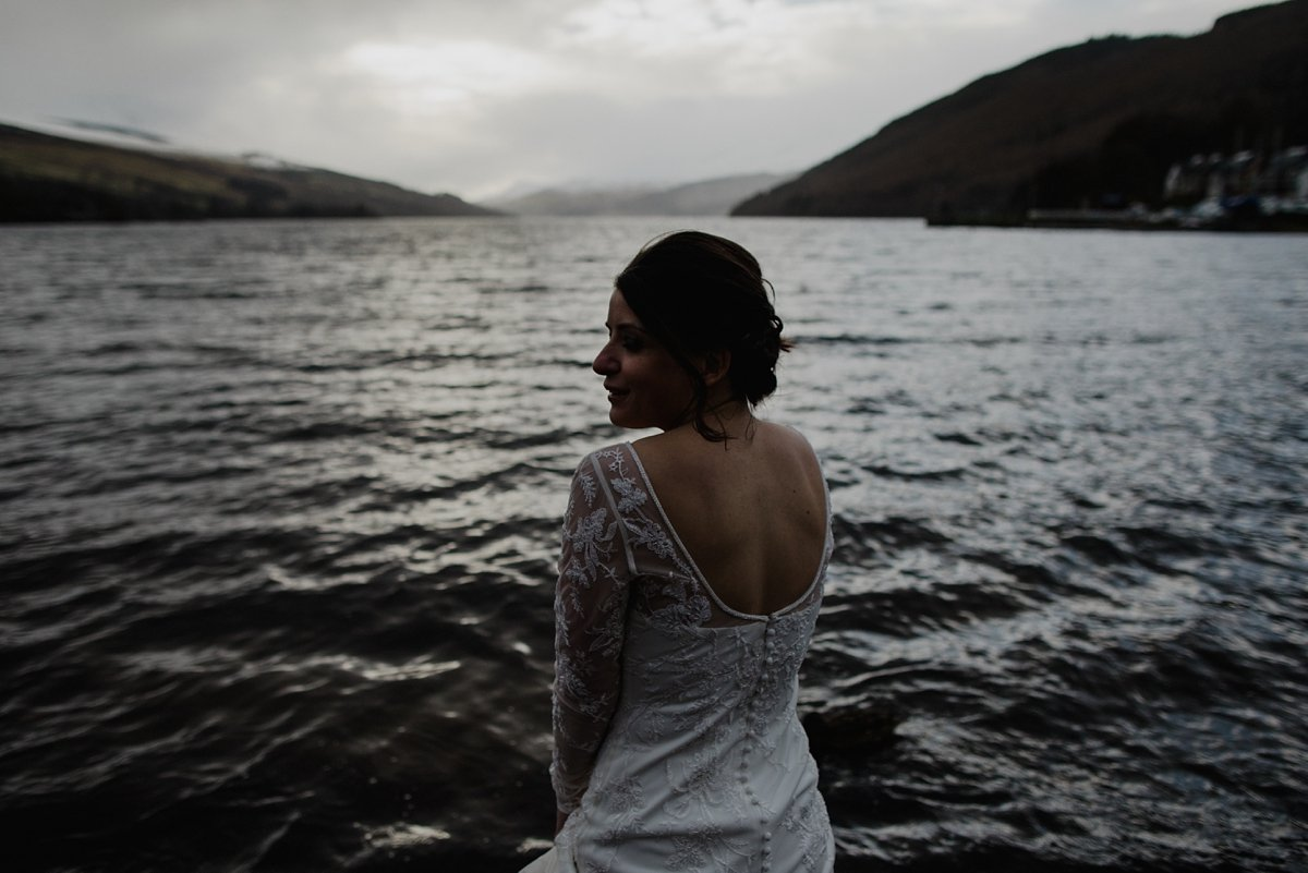 atmospheric portrait of bride by the water's edge