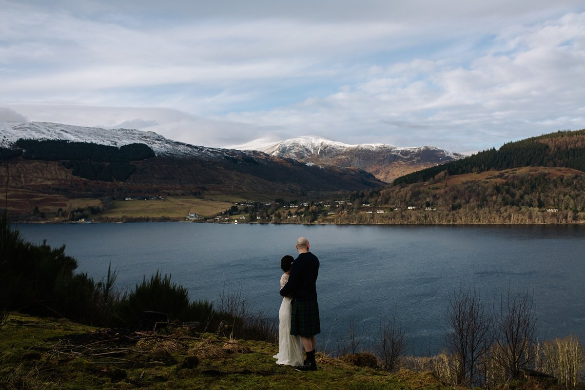 bride and groom taking in the views over loch tay