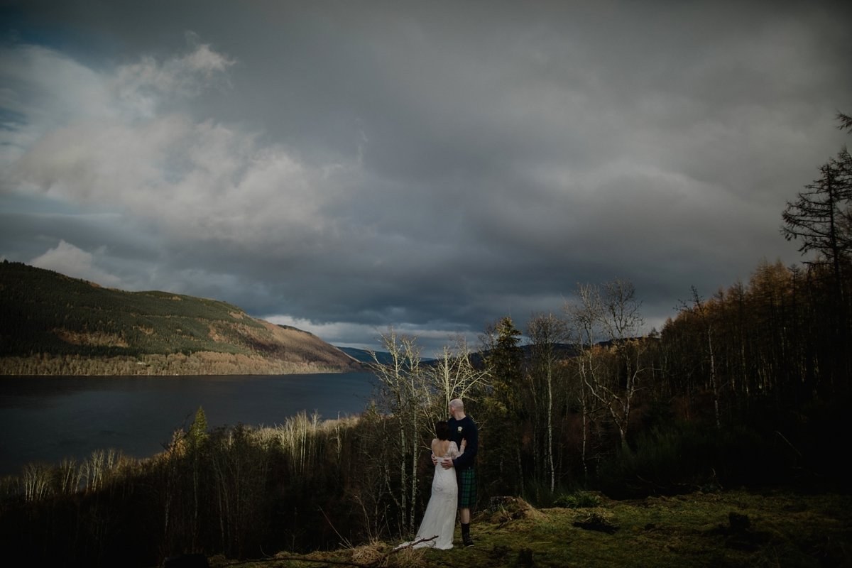 image of bride and groom with loch tay scenery