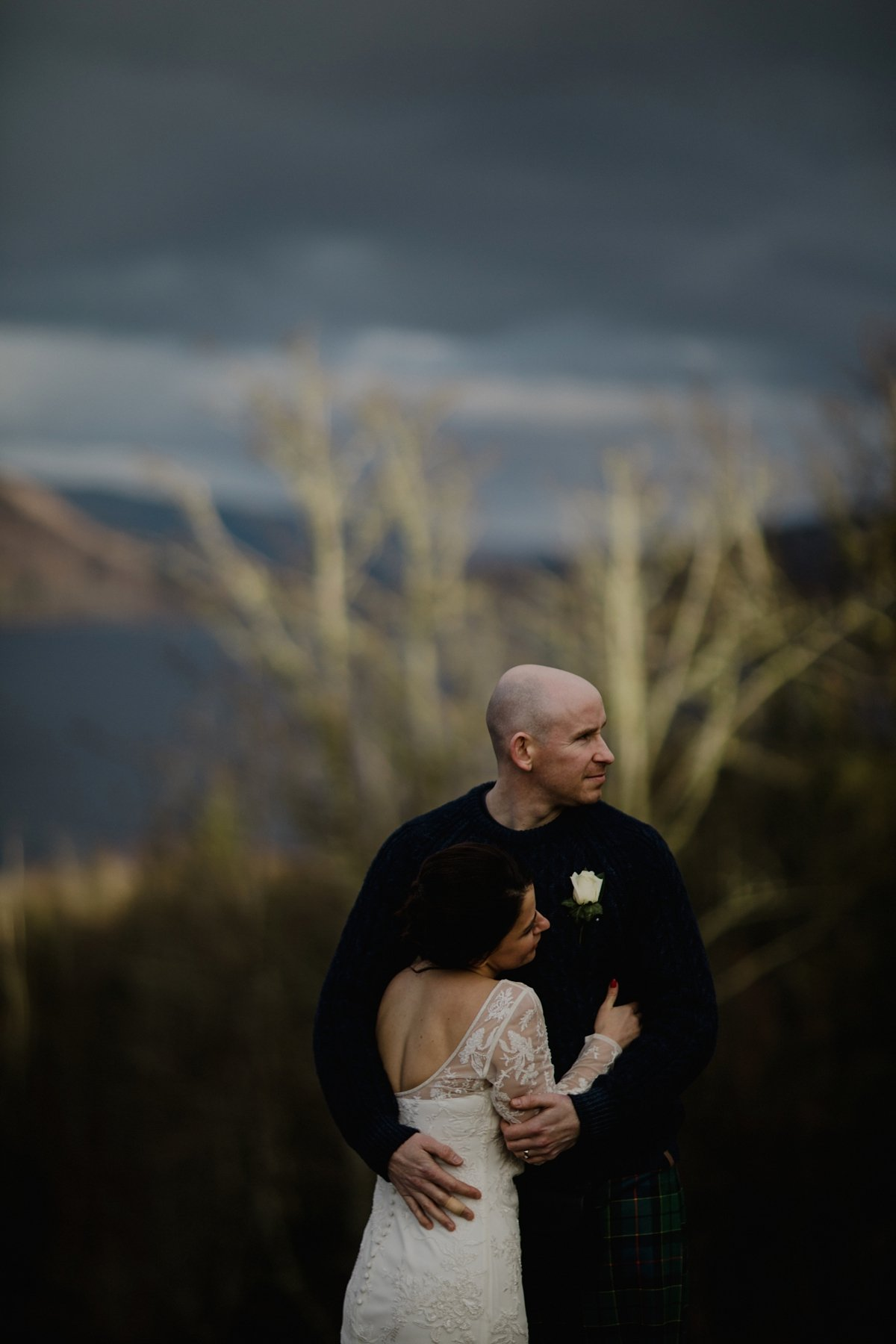 moody portrait of bride and groom