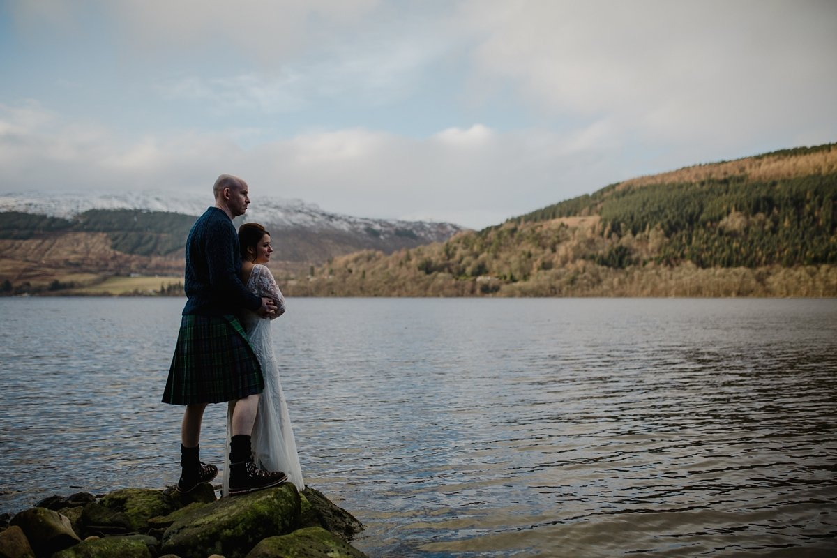 atmospheric portrait of bride and groom on the banks of loch tay