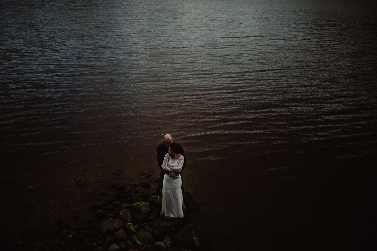 moody portrait of bride and groom taken by loch tay