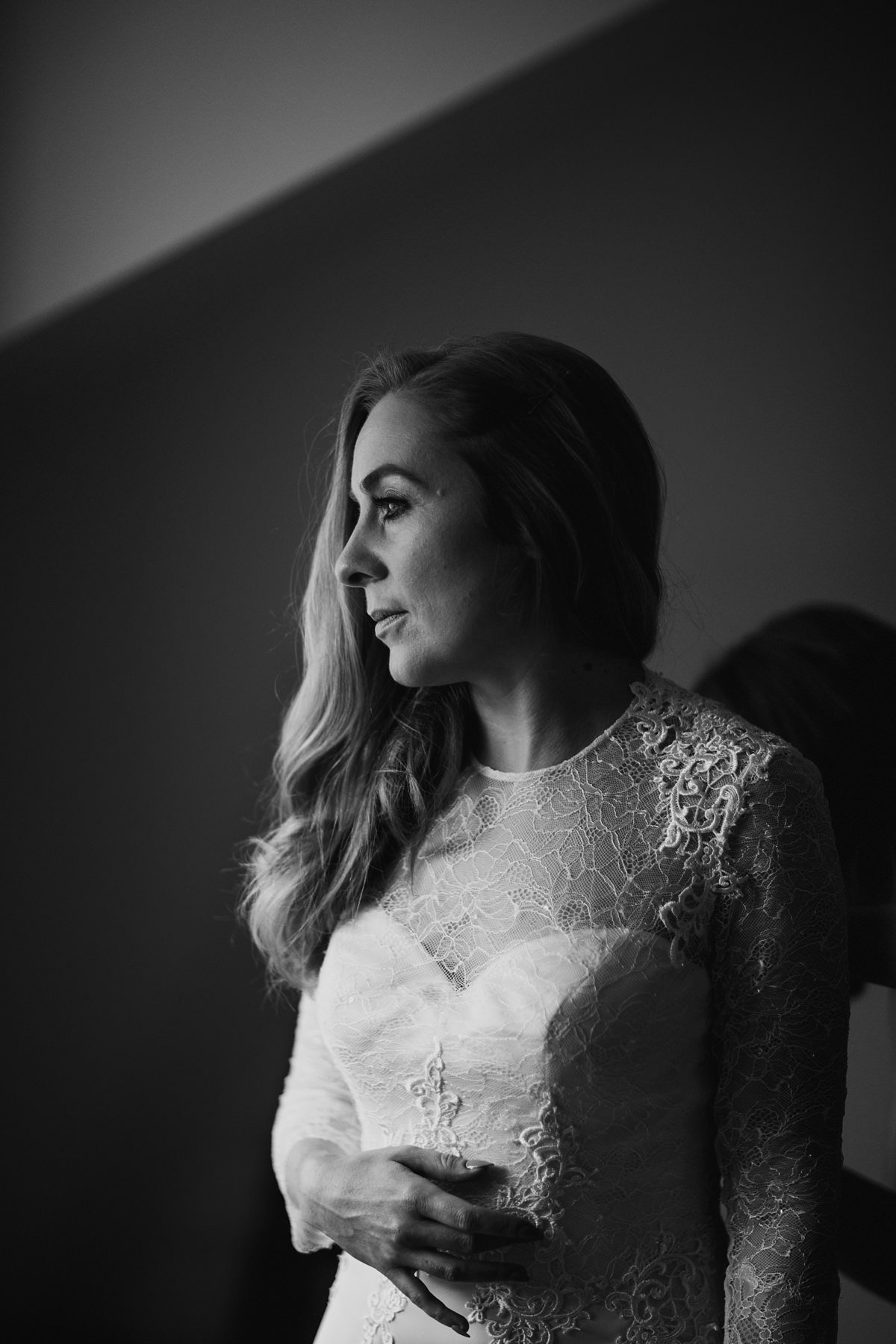 black and white portrait of a nervous bride taken by the window