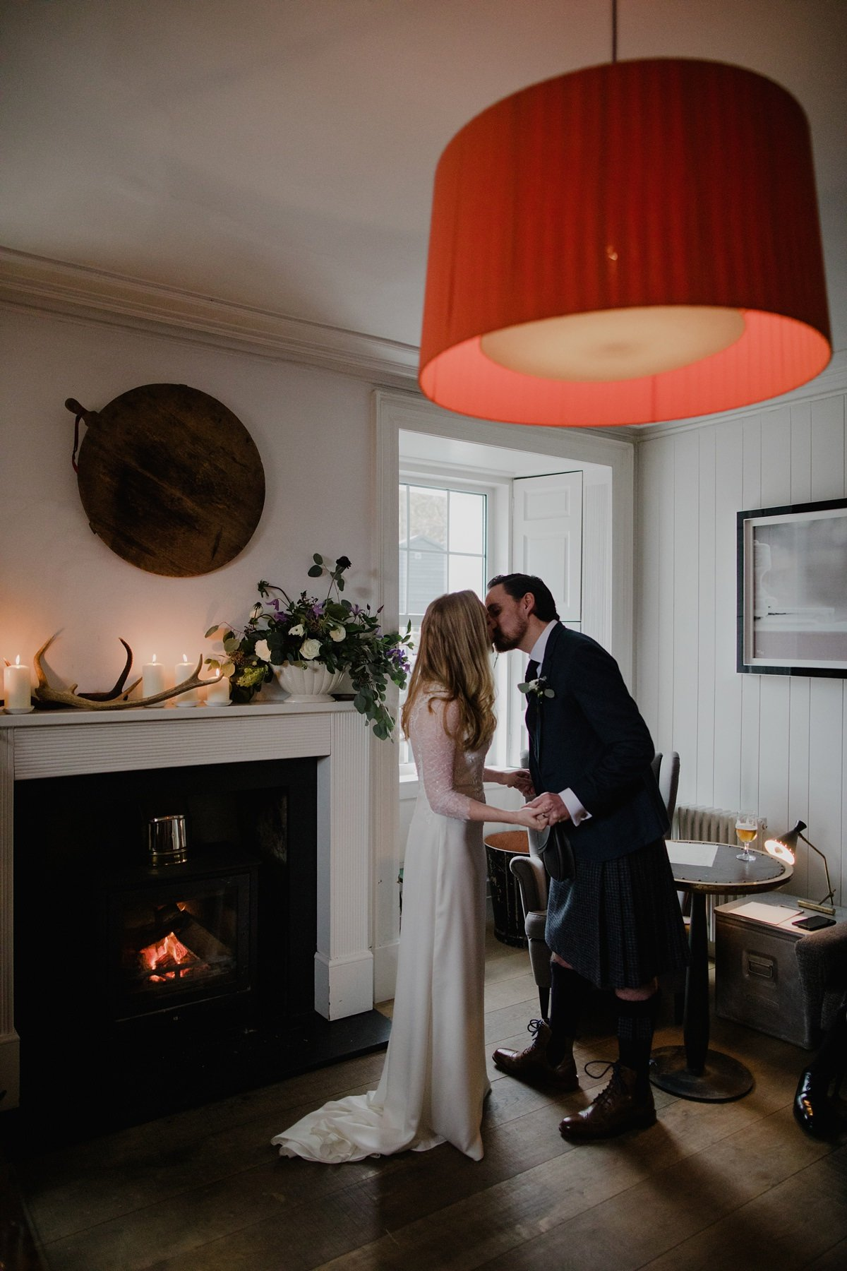 first kiss in the sitting room by the fire at monachyle mhor hotel
