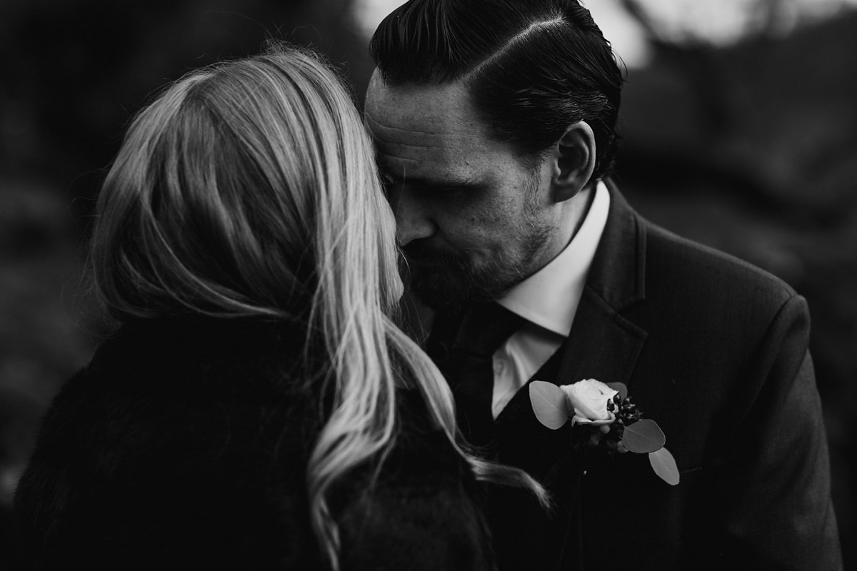 black and white of intimate moment between bride and groom