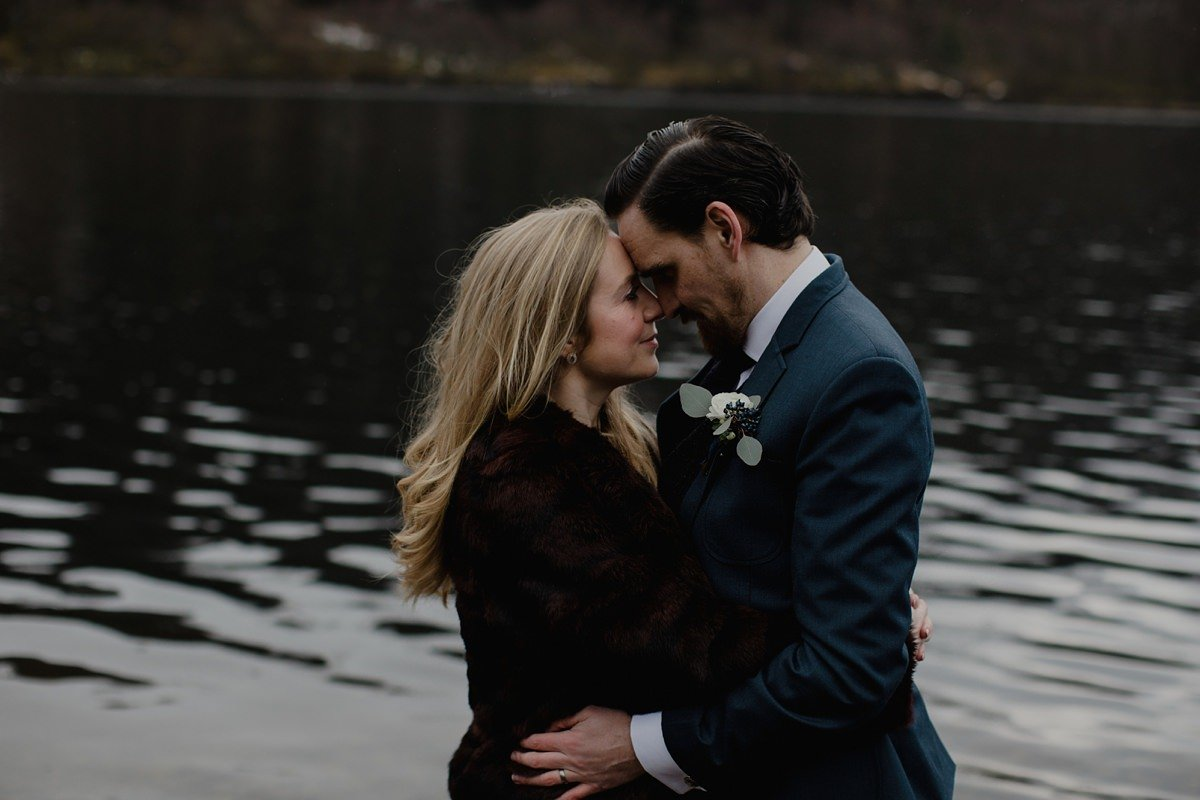 intimate portrait of wedding couple by the loch
