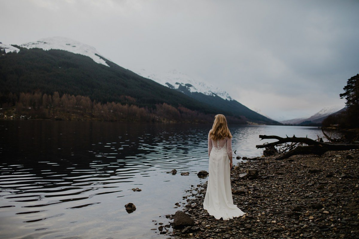 landscape portrait of bride facing out to the scenery surrounding monachyle mhor hotel