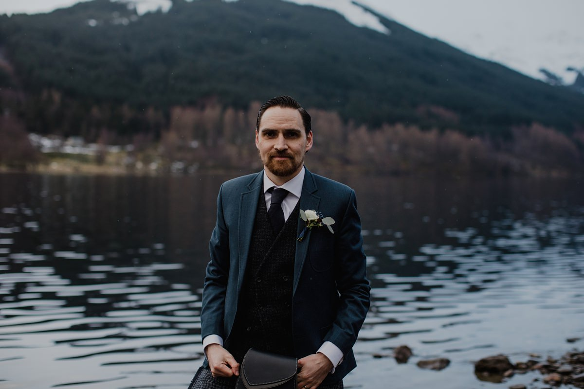 portrait of groom on the lochside