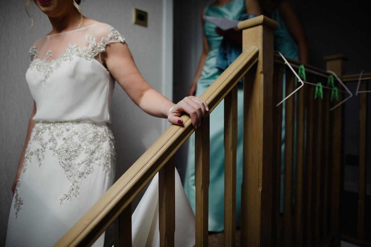 bride walking down the stairs of her home to go to her wedding ceremony