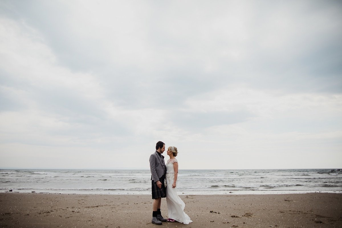 bride and groom together on the beach