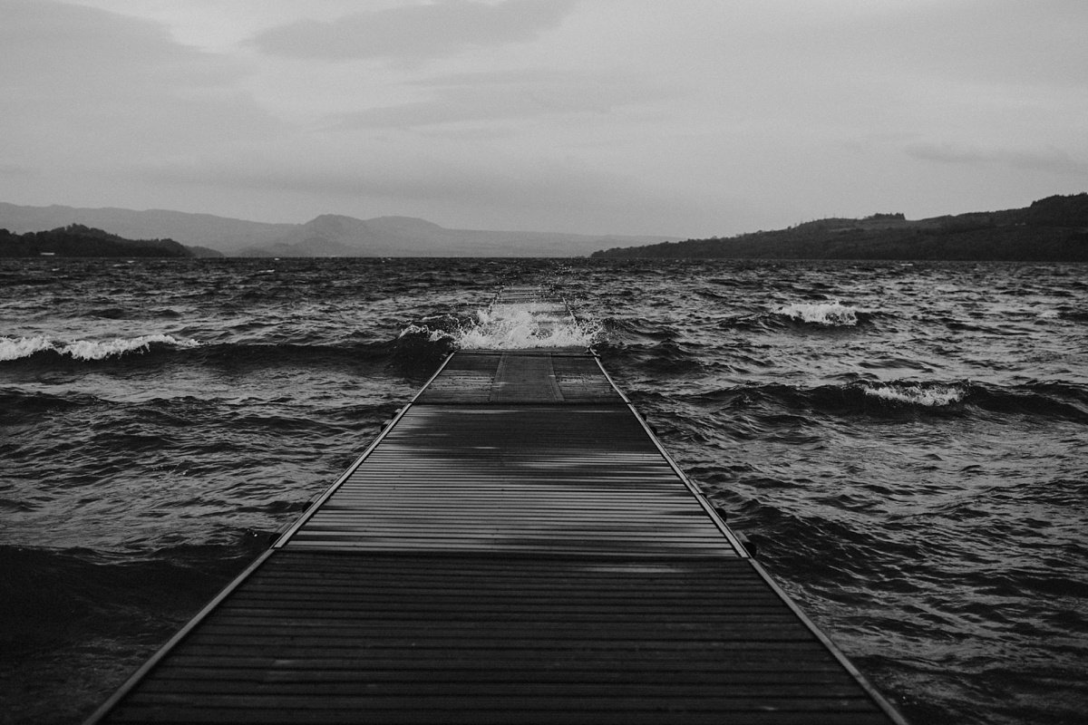 jetty in stormy water at the cruin loch lomond