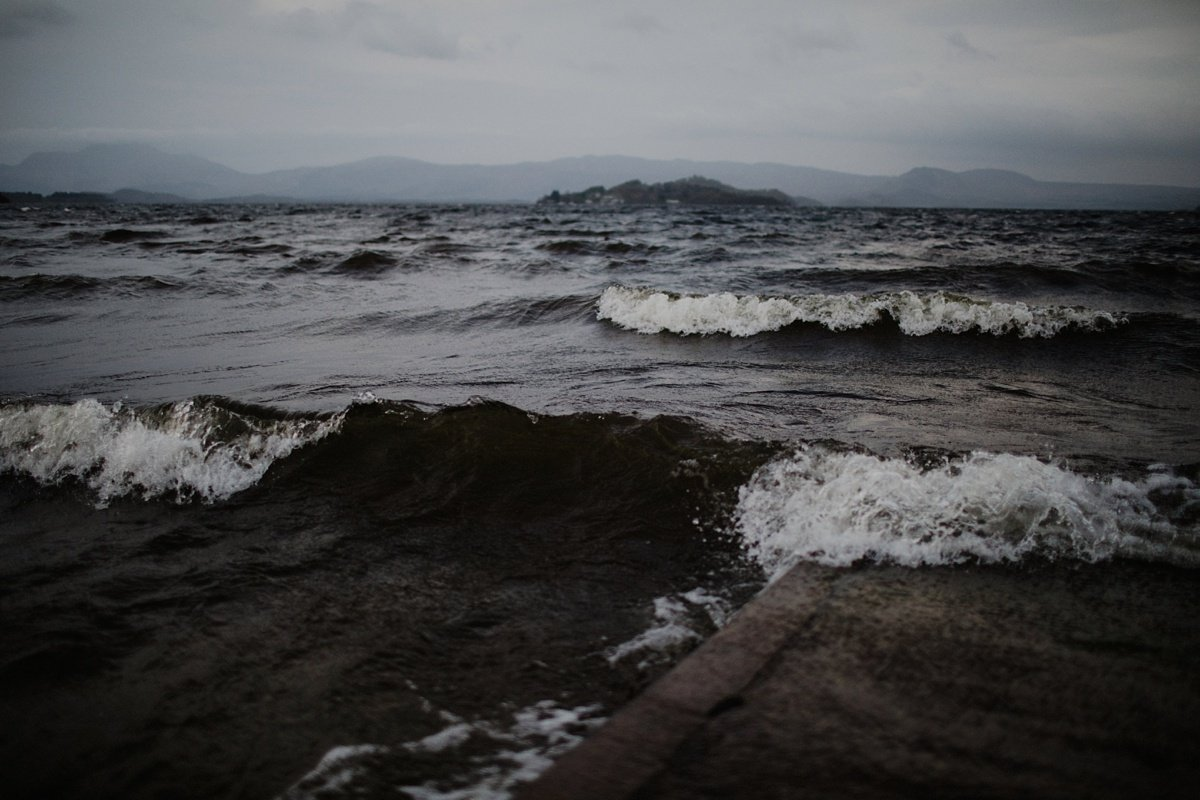 waves lapping over the jetty, wedding at the cruin loch lomond