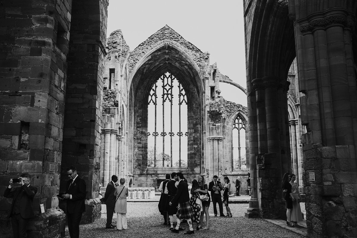 guests arriving for ceremony at melrose Abbey