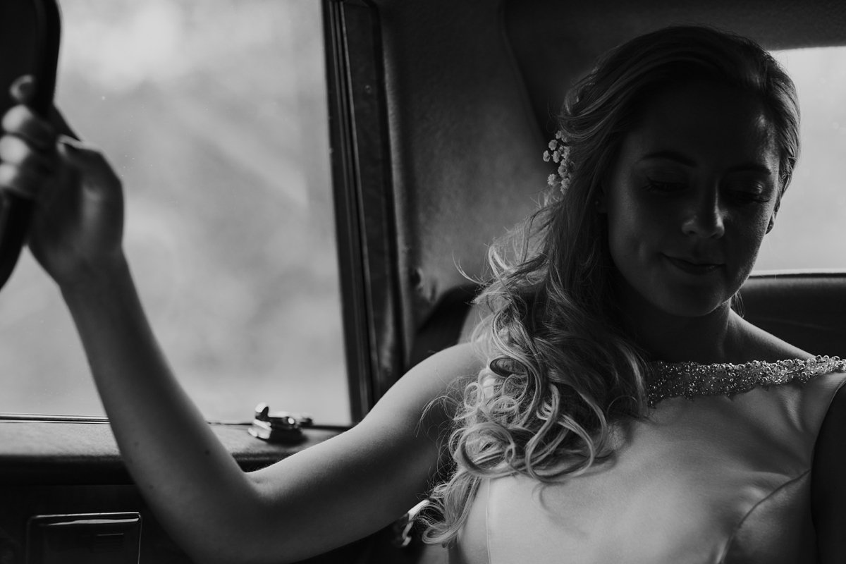 bride in car going to her ceremony at melrose abbey