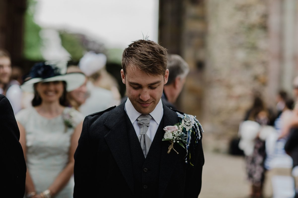 groom waiting at melrose abbey wedding ceremony