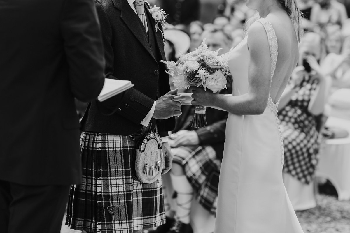 wedding couple holding hands at their melrose abbey wedding ceremony
