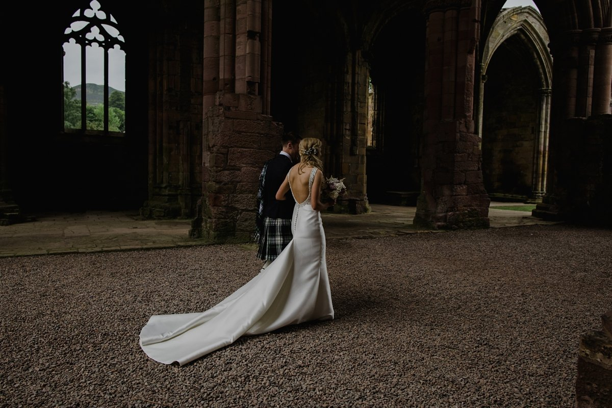 bride and groom exit from melrose abbey wedding ceremony